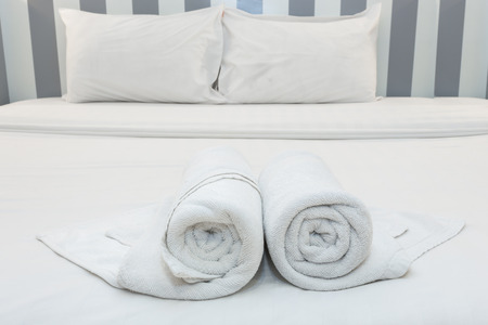 honeymoon suite: Close up of nice towels on white bed sheet with white pillow
