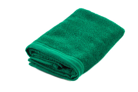 Green soft bath towel isolated on white background