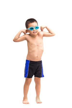 naked child: Young asian boy in swimsuit and blue swim goggles