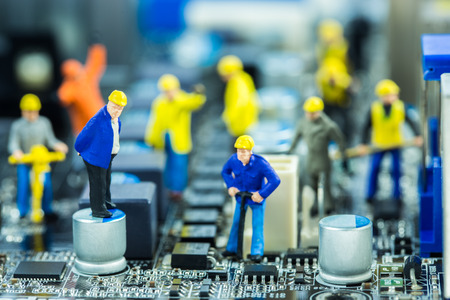 Boss and Team of engineers repairing circuit mother board. Computer repair concept