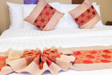 romance bed: Close up of nice Red Fabric Texture with circle shape on white bed sheet with red circle shape texture on pillow Stock Photo