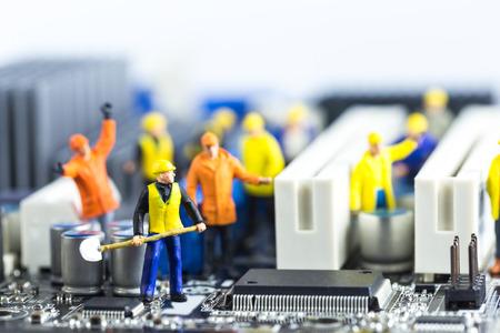 Team of engineers repairing circuit mother board. Computer repair concept