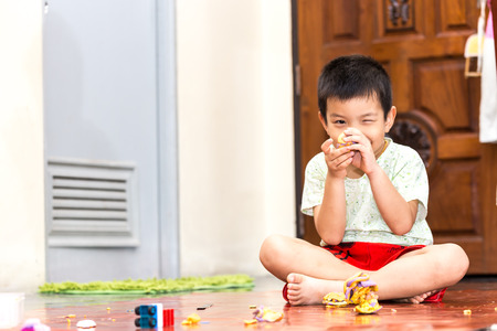 tinkering: kids boy with play clay toys at home