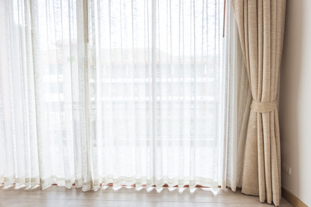curtain background: Light shines through white curtains in room Stock Photo