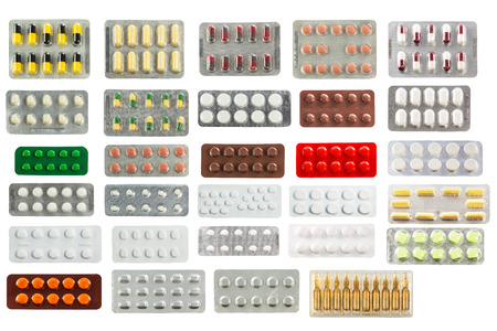 pharmacy pills: collection of pills in transparent blister packs isolated on white background
