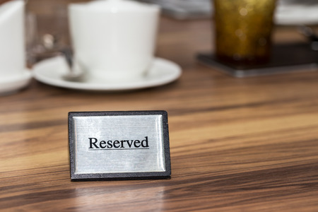 reserved seat: Reserved sign on a restaurant table Stock Photo