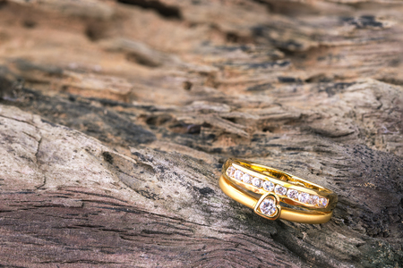 diamond shape: Heart shape diamond ring on old wood texture Stock Photo