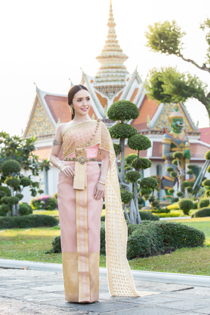 bead embroidery: Thai woman wearing Thai traditional bridal dresses (Thai Chakri). Dress of Thai silk and metal thread brocade with Bead and sequin embroidery. Stock Photo