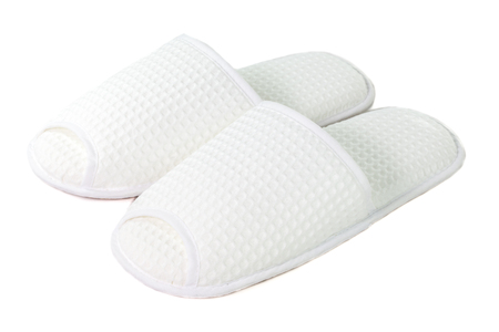 A pair of white slippers on a white background. Standard-Bild