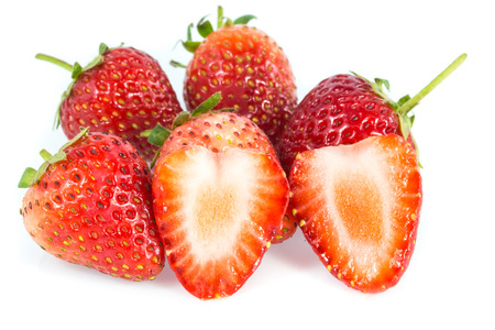 endorphine: Strawberries and cut strawberry isolated on white background Stock Photo