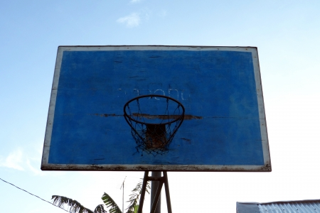Typical privately owned basketball hoop with wooden backboard in the Philippines photo
