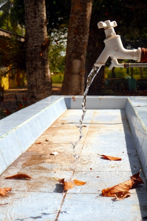 safe drinking water: An Open Faucet with Running Water
