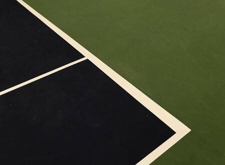 dark blue and white lines shape with dark green surface at the end of tennis indoor court, using for background