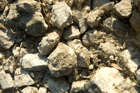 Stones and cracked concrete around build in country side, Thailand Stock Photo