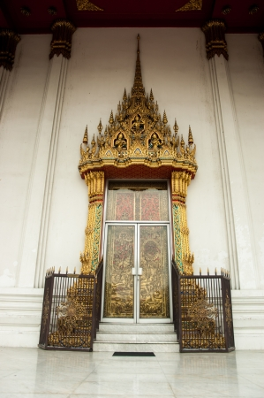 This is Thai decorative style gateway of thai temple. On the door are musiciens there are play lute, pipe and flute. They celebrate for Buddha Birthday. Stock Photo - 14054272