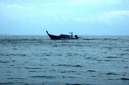 long tailed boat: Go with Long-tailed boat in Krabi sea in cloudy day  It have some rain  Stock Photo