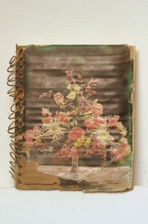 commemoration: Very old diary with vintage flower picture at the cover of book.
