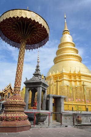 Travel landmark, the Golden Pagoda at Wat Phra That Hariphunchai in Lamphun province photo