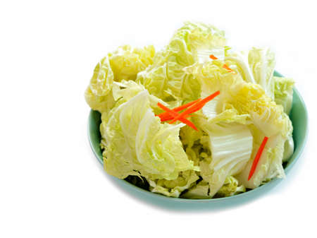 Slicing chinese cabbage and slicing carrot in dish isolated photo