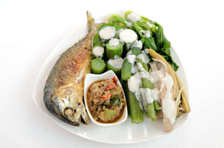 Fired mackerel with chili paste and steam vegetable photo