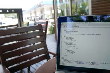Screen of program coding on laptop at coffee shop