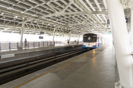 Bangkok, Thailand - October 10, 2014: BTS Sky train is growing in Bangkokdue to the rise in the number of passengers and the extension line of the elevated train system. Редакционное