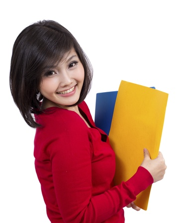 pretty young female holding folder Stock Photo - 12731933