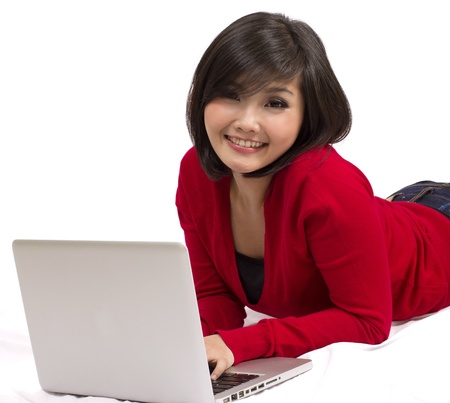 pretty young female using laptop Stock Photo - 12731672