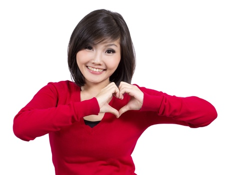 pretty young girl making heart sign  photo
