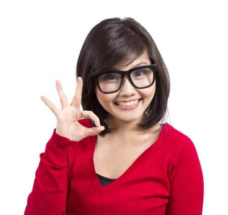 nerd glasses: beautiful young girl wearing nerd glasses making okay sign  Stock Photo