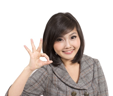 beautiful young business woman making okay gesture  photo