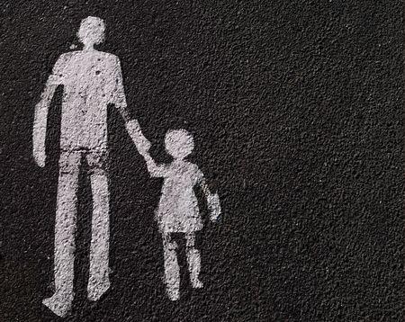 Parental guidance - a way for pedestrians sign on asphalt.