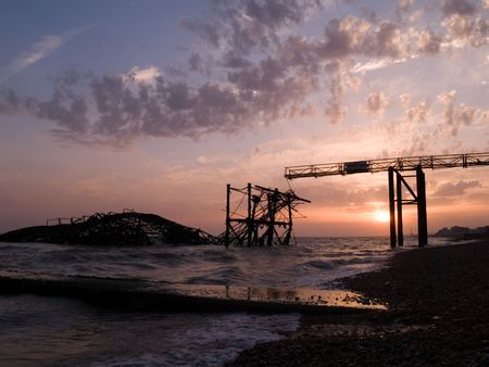 The collapsed Brighton West Pier at sunset.