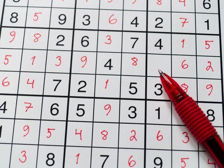 Pen on a sudoku grid.