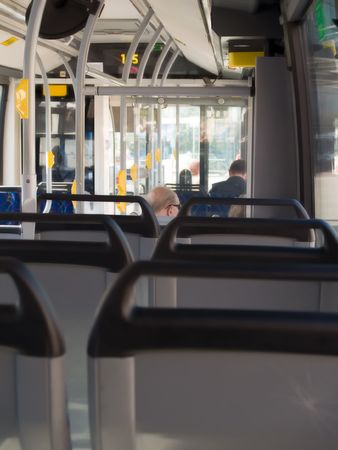 Public Transport - Elderly couple in a bus Stock Photo