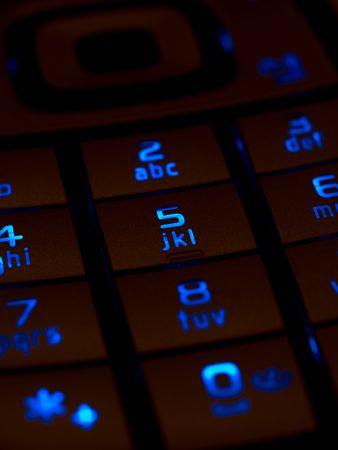 ringtones: Lit keypad of a mobile phone in dark.