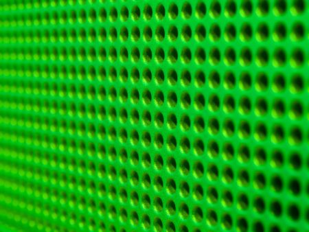 Futuristic green hole grid making an abstract pattern. Stock Photo - 719454