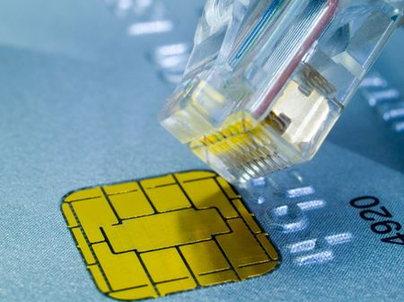 wire pin: Credit card and a network cable representing online shopping. Stock Photo