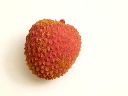 An exotic lychee fruit isolated on a white background.