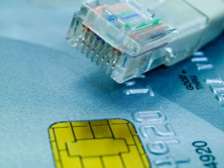 Credit card and a network cable representing online shopping. Shallow DOF. photo