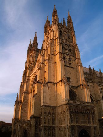 Canterbury Cathedral at sunset against a blue sky