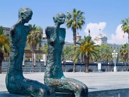 couple statues sitting in the marina in Barcelona Stock Photo - 990868