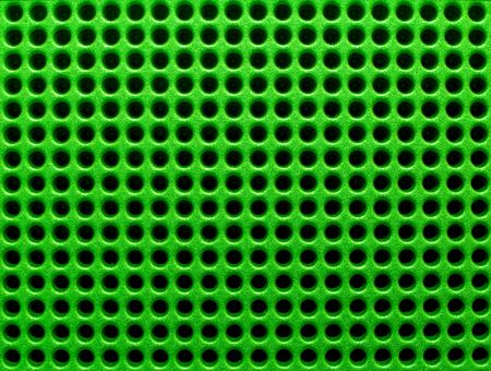 Futuristic green hole grid making an abstract pattern. Stock Photo - 1364010