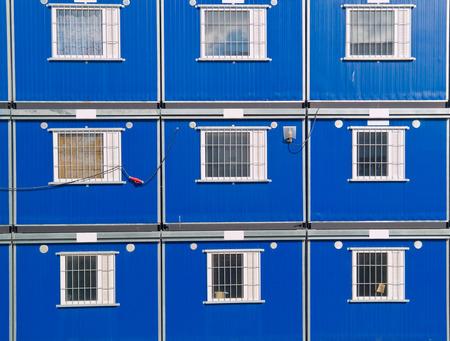 barracks: Blue barracks on a construction site