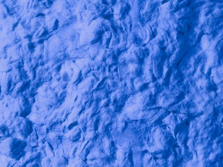 An abstract background of blue paper pulp close-up.