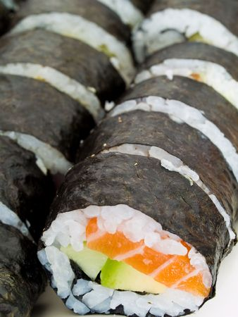 Rows of homemade maki sushi rolls