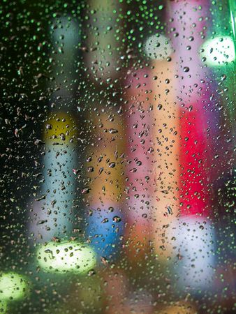 An abstract of colorful citylights through an umbrella in rain