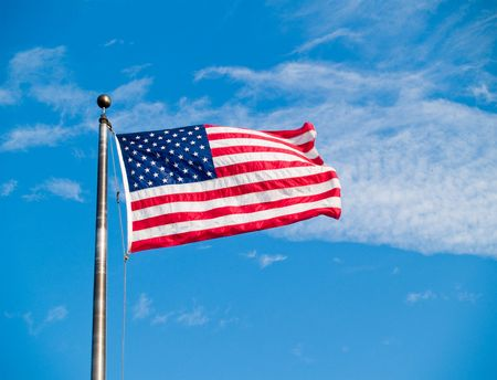 The US stars and stripes flag waving in the wind Stock Photo