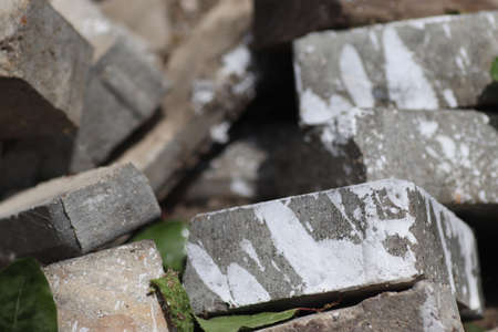 gray stones with splashes of white paint, the effects of the rack, on a sunny day stones on the ground