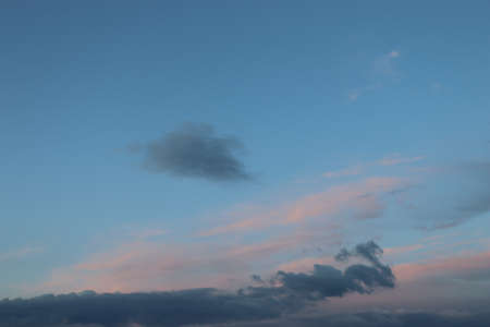 in the blue sky pink blue and white clouds, cloudy beautiful sky